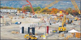 ?? TIMES-TRIBUNE FILE ?? Construction of the Lackawanna Energy Center gas power plant in Jessup is underway, with critics claiming that the project shortchanges the community.