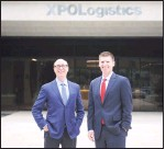 ?? Hearst Connecticut Media file photo ?? XPO Logistics CEO Bradley Jacobs, left, and President Troy Cooper outside the company's headquarters at 5 American Lane in Greenwich on July 25, 2017.
