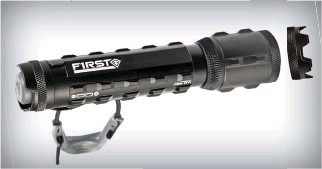 ??  ?? Above: Two unique features of the First Tactical Medium Tritac flashlight include the option of installing an aggressive crenellated bezel or a smooth bezel and the finger bungee retention system that reduces the chance of dropping the flashlight.