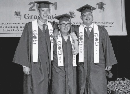 ?? CONTRIBUTED ?? Logan Prosper, right, stands arm and arm with two of his friends at their graduation ceremony at We'koqma'q Mi'kmaw School on June 16. With him are, from left, Brayden Googoo and Owen Bernard.