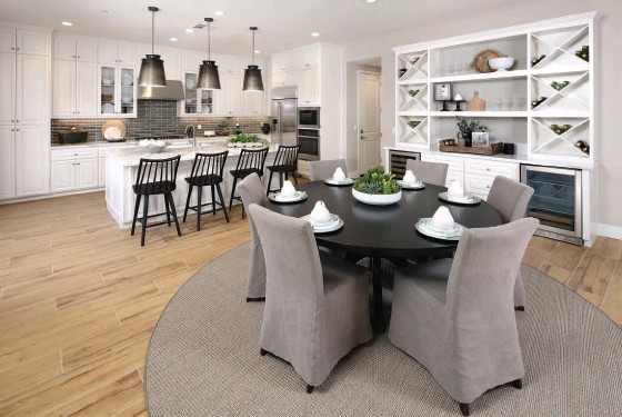 ?? SHEA HOMES ?? Clean design and hardwood floors make great rooms at The Enclave something special.