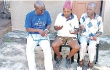 ??  ?? AUTHOR Fred Khumalo, left, with childhood friends Senzo Khumalo, centre, and Sizwe Mkhwanazi during a visit back to his roots in Hammarsdale, Kwazulu-natal.