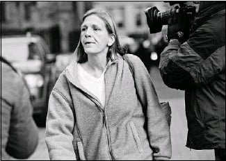 ?? Louis Lanzano/Bloomberg ?? Joann Crupi, a former employee of Bernard L. Madoff Investment Securities LLC, exits federal court after posting bail in New York on Friday. Crupi, who worked for Madoff for 27 years, was arrested Friday in connection with the money manager's...