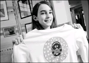 ?? By Jack Gruber, USA TODAY ?? Winner: Riley O'Callaghan, now10, designed the winning T-shirt in a Lands' End contest for kids.