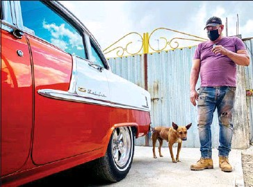 ?? AFP ?? Panel beater Pedro Manso checks a Chevrolet BelAir 55 car rebuilt by him in his workshop in the town of Placetas, Villa Clara province, central Cuba, last month.