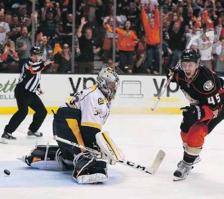 ?? VICTOR DECOLONGON/GETTY IMAGES ?? Sami Vatanen, right, of the Anaheim Ducks reacts after scoring the eventual game-winner on a breakaway against goaltender Pekka Rinne of the Nashville Predators, in the third period of Anaheim's 5-2 win in Game 5 on Saturday, in Anaheim, Calif.