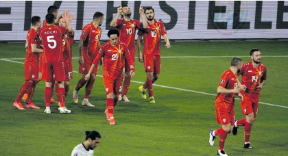 ?? Photo: Thilo Schmuelgen/Getty Images ?? Up against a German team stacked with stars, North Macedonia pulled off a historic 2-1 win against the home team in the Fifa World Cup 2022 Qatar qualifying match in Duisburg, Germany recently.