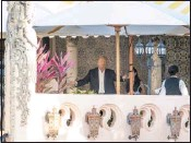 ?? ANDREW HARNIK / ASSOCIATED PRESS ?? President-elect Donald Trump, center, speaks to an aide at Mar-a-Lago resort in Palm Beach, Fla., on Monday.