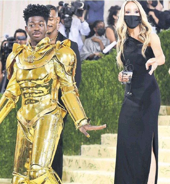 ?? PHOTOGRAPH: ANGELA WEISS/AFP/GETTY IMAGES ?? The US rapper Lil Nas X is resplendent in gold armour as he arrives for the 2021 Met Gala on Monday night