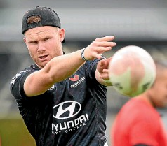?? GETTY IMAGES ?? Mitchell Drummond delivers a pass at Crusaders training in Christchurch on Thursday.