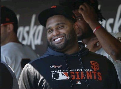 ?? KARL MONDON — BAY AREA NEWS GROUP ?? The San Francisco Giants' Pablo Sandoval smiles in the dugout before a game in 2019. Sandoval now plays for the Atlanta Braves.