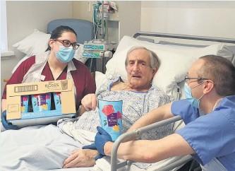 ??  ?? Generous John Wackett with senior nurse Rachel Hunt and consultant physician Paul Cadden
