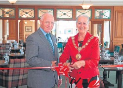 ?? Picture: Paul Reid. ?? Angus Provost Helen Oswald performs the official opening with general manager Gordon Mackintosh.