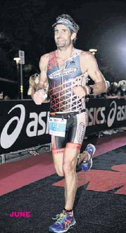 ??  ?? IRONMAN: Dene Burls (below), who less than 12 months earlier 'couldn't swim 25 metres', completes Cairns Ironman Triathlon. The Ironman is composed of a 3.8km ocean swim, 180km bike ride, and 42km run. JUNE