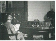 ?? (Special to The Commercial) ?? A WOK announcer works during the early days of the radio station.