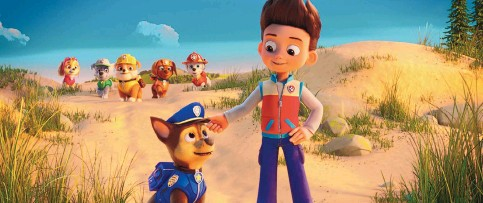 """?? SPIN MASTER/PARAMOUNT PICTURES ?? Foreground: Chase (voice of Iain Armitage, left) and Ryder (Will Brisbin) in """"Paw Patrol: The Movie."""" Background, from left: Skye (Lilly Bartlam), Rocky (Callum Shoniker), Rubble (Keegan Hedley), Zuma (Shayle Simons) and Marshall (Kingsley Marshall)."""
