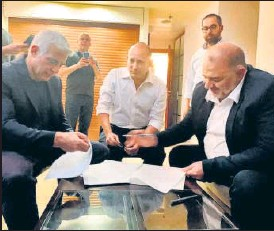 ?? AFP ?? Israeli PM Benjamin Netanyahu (above) attends an event; the troika of Yair Lapid, Naftali Bennett and Mansour Abbas (left to right) sign their historic coalition pact.
