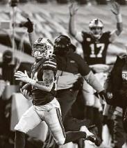 ?? Adrian Kraus / Associated Press ?? Bills cornerback Taron Johnson's 101-yard interception return sealed Buffalo's victory.