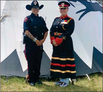 ?? Photo contributed ?? Insp. Farica Prince is working towards racial and gender equality for all in Canadian policing. Here Prince (right) and A/Sgt. Hadiga Little Wolf for a photo.