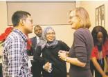 ??  ?? Raymundus Rikang Rinangga Widya from Indonesia (left) and Alyaa Abdul Aziz Alhadjri from Malaysia (center) speak with a guest.