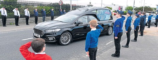 ?? Photographs by Kenny Elrick ?? GUARD OF HONOUR: Members of the Boys' Brigade salute as the hearse arrives at Kirkton Cemetery.