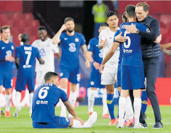 ?? Photo / AP ?? Chelsea manager Thomas Tuchel, right, celebrates with Jorginho after the Champions League quarter-final second leg match against Porto in Seville.