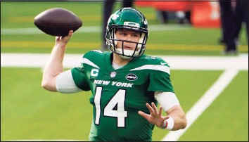 ?? Jae C. Hong / Associated Press ?? Sam Darnold's future with the Jets is uncertain after GM Joe Douglas said he would entertain calls from other teams interested in the quarterback.