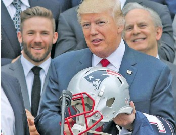6fc17f8d5b9 US President Donald Trump holds a New England Patriots helmet as Patriots  head coach Bill Belichick and Patriots player Julian Edelman