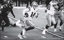 ?? THE ASSOCIATED PRESS ?? Cowboys QB Andy Dalton returned frominjury Sunday to throwthree TD passes. He'll lead Dallas againstWashington Thursday with first place in the division on the line.