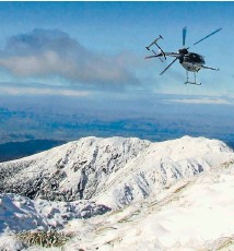 ??  ?? Flying high above snow covered Tararuas.