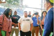 ?? IAN MAULE/TULSA World file ?? Mayor G.T. Bynum (right) speaks to Tiffany Crutcher (left), Nat Wachowski-estes (center) and others after a 2019 City Council meeting about police use of force.