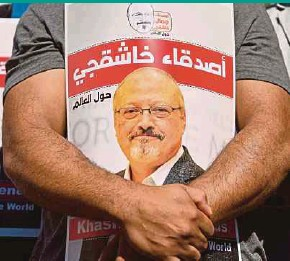 ?? AFP PIC ?? Friends of murdered Saudi journalist Jamal Khashoggi holding posters bearing his picture as they attend an event marking the second year anniversary of his assassination in front of the Saudi Arabia Istanbul Consulate on Oct 2 last year.