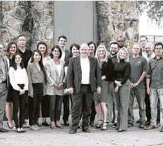 ?? Courtesy photo ?? Data Gumbo CEO Andrew Bruce, center, with staff members at the Houston company.