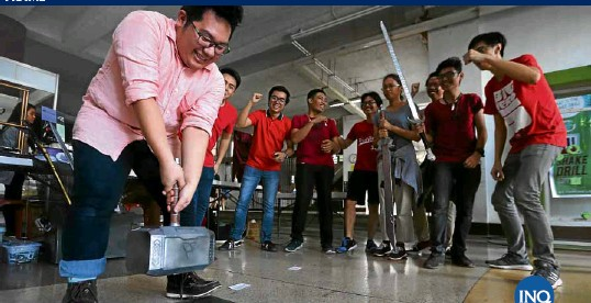 ??  ?? ONLY THEWORTHY Many tried but few succeeded in lifting a version of the Mjölnir, the hammer of the Marvel comicbook hero Thor, at a side attraction of the NGOSummit held Thursday at Palma Hall on the University of the Philippines campus in Diliman. The hammer is held firmly in place by an electromagnet, which makes moving it off the plate a mythic challenge. —LYN RILLON VISIT SITE FOR MORE PHOTO ESSAYS frame.inquirer.net