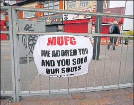 ?? AFP ?? A banner against the proposed Super League hangs from railings of the Manchester United's Old Trafford stadium. The proposed Super League flopped after all six English clubs withdrew.