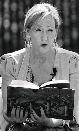 ?? Chip Somodevilla/Getty Images ?? British author J.K. Rowling, creator of the Harry Potter fantasy series, reads from Harry Potter and the Sorcerer's Stone during the Easter Egg Roll on the South Lawn of the White House in April.