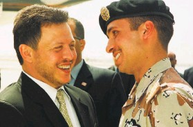 ?? Yousef Allan / Associated Press 2001 ?? Jordan's King Abdullah II (left) and half brother Prince Hamzah in happier days. Hamzah's employees and associates are still being held incommunic­ado.