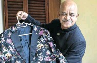 ?? Pictures: Rogan Ward ?? Tailor Janak Parekh, who has designed suits for King Goodwill Zwelithini, below, and many other notables and politicians, shows off one of his elaborate creations at his home in North Beach, Durban.