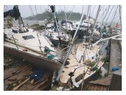 ??  ?? Below: cruisers fear they may not find safe haven for the Pacific cylone season; yachts were caught when Cyclone Pam devastated Vanuatu in 2014