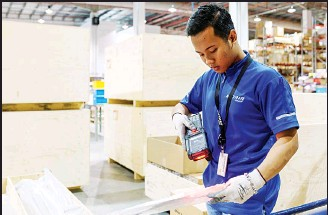 ??  ?? This photograph taken on March 4, 2018 shows a staff member scanning an aircraft part at the Satair regional storage facility in Singapore's Seletar Aerospace Park. Airbus and Boeing may have built their global success on the back of the...