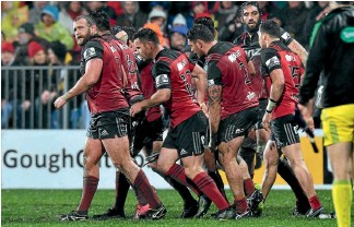 ?? PHOTO: GETTY IMAGES ?? Loosehead prop Joe Moody (left) revelled in the mud and rain as the Crusaders beat the Highlanders 17-0 in the Super Rugby quarterfinal at AMI Stadium on Saturday night.