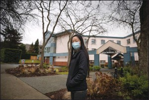 ?? The Canadian Press ?? Bernadette Cheung stands outside Little Mountain Place, where her grandmother died from COVID-19, in Vancouver recently. A new independent report points to confusion inside B.C. long-term care homes about how to control coronavirus.