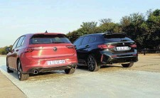 ?? ?? With its red accents the 128ti is more striking from the rear than the GTI. Below left: The Golf GTI's cabin fully embraces the digital era but isn't user friendly. Below right: The BMW 128ti's interior feels more premium and the controls are easier to use.