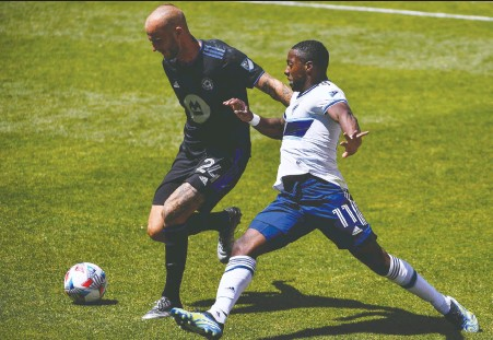 ?? ALEX GOODLETT/GETTY IMAGES ?? The Whitecaps' Cristian Dajome, right, and Aljaz Struna of CF Montréal fight for the ball during Saturday's game in Utah.