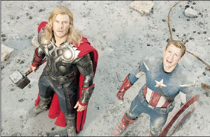 ?? — DISNEY ?? Eye candy aside, by courtesy of Chris Hemsworth as Thor and Chris Evans as Captain America in the Avengers, the film industry is trying to cash in by attracting more female viewers.