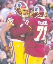 ?? 2015, THE ASSOCIATED PRESS ?? Jordan Reed and TrentWilliams celebrate a touchdown in Washington in 2015.