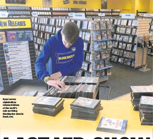??  ?? Ryan Larrew alphabetizes returned videos at the world's sole surviving Blockbuster store in Bend, Ore.