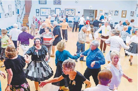 ??  ?? Couples square dance at Maple Grove Grange in Denver on July 14.