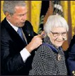 ?? By Chip Somodevilla, Getty Images ?? Rare appearance: President Bush presents the PresidentialMedal of Freedomto author Harper Lee at the White House in 2007.