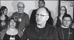?? Star photo: Nick Brancaccio ?? CONTROVERSIAL: CUPE Ontario president Sid Ryan, centre, speaks to the media in The Windsor Star room at the Hilton Windsor during a news conference on Sunday.